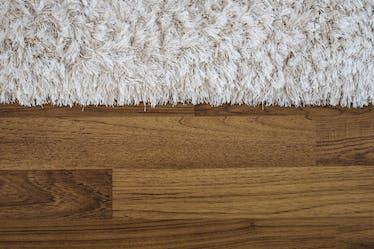 Carpet on a teak wood floor make a perfect floor experience