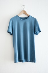 Blank blue T-Shirts are laminated using thermoplastic and reactive hot melt adhesives