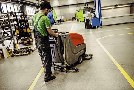 employee cleaning production